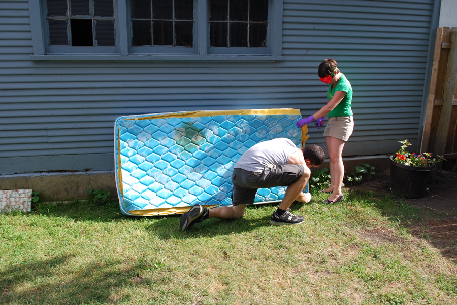 """We started out by cutting around the exterior of the mattress. The goal is to save the edge of the mattress with piping to use for """"cleanly"""" finishing the rabbit's side"""