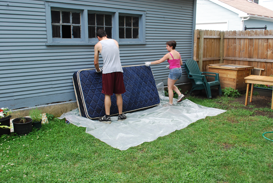 A really nice blue mattress. The edge is wet from the rain, the plastic didn't cover all of it.