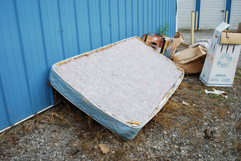 We went to drop off our mattress skeleton at Matt's storage space.  When we got there we noticed that there was a partially skinned mattress just lying there.
